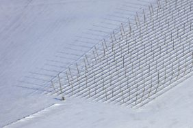 Aerial view of a high seat and hop poles in the snow - Klaus Leidorf Aerial Photography