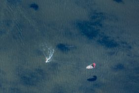 Aerial view of a kitesurfer on the Vilstal reservoir near Marklkofen - Klaus Leidorf Aerial Photography