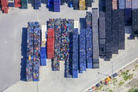 Aerial view of a storage area for colourful beverage crates - Klaus Leidorf Aerial Photography