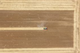 Aerial view of a combine harvester at work - Klaus Leidorf Aerial Photography