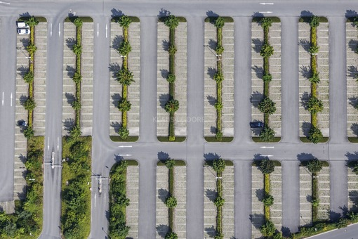 Aerial view of a parking lot with green strip - Klaus Leidorf Aerial Photography
