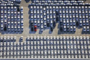 Aerial view of a parking lot full of new Audi cars in the industrial area Bachl at the exit Abensberg of the A93 - Klaus Leidorf Aerial Photography