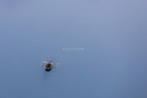 Aerial view of a rowing boat on the quarry pond - Klaus Leidorf Aerial Photography