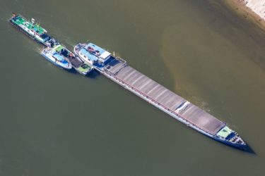 Aerial photograph of a convoy of ships near Aicha on the Danube - Klaus Leidorf Aerial Photography