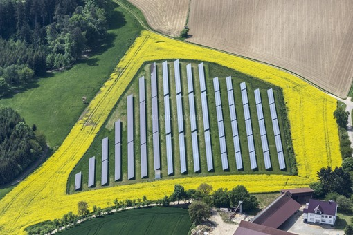 Aerial view of a solar field with a yellow frame of flowering rape - Klaus Leidorf Aerial Photography
