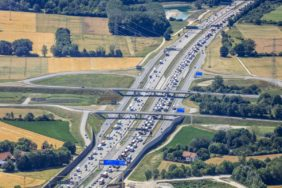 Aerial view of a traffic jam on the motorway A99 near Aschheim - Klaus Leidorf Aerial Photography