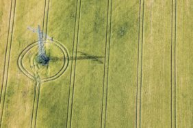 Aerial view of a power pole in a grain field - Klaus Leidorf Aerial Photography