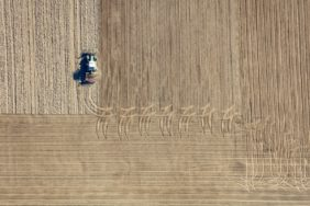 Aerial view of a tractor working in the field - Klaus Leidorf Aerial Photography