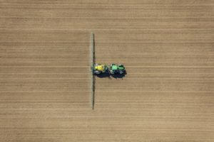 Aerial view of a tractor during spraying - Klaus Leidorf Aerial Photography