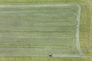 Aerial view of a tractor making hay - Klaus Leidorf Aerial Photography