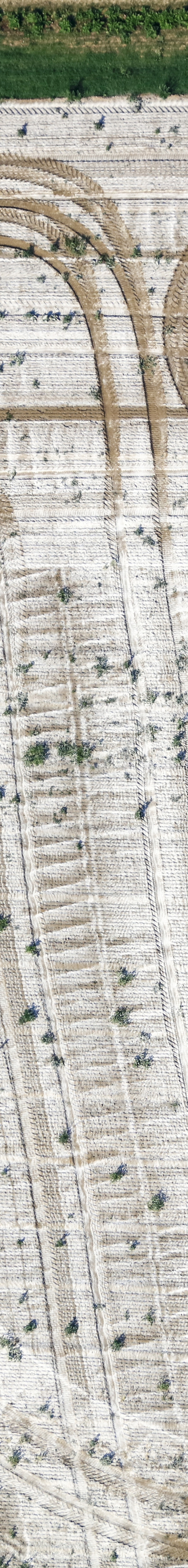 Aerial view of a tractor with sprayer shortly before completion of the lime spraying work - Klaus Leidorf Aerial Photography
