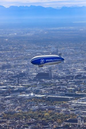 Aerial view of a zeppelin over the old town in Munich - Klaus Leidorf Aerial Photography
