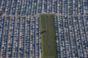 Aerial photograph of a temporary storage facility for brand new cars and a corn field - Klaus Leidorf Aerial Photography