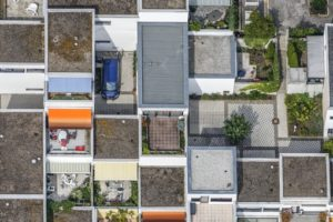 Aerial view of a blue bus in a housing estate - Klaus Leidorf Aerial Photography