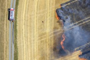 Aerial view of a burning grain field - Klaus Leidorf Aerial Photography