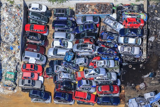 Aerial view of a densely packed pile of old cars - Klaus Leidorf Aerial Photography
