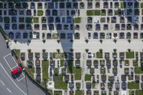 Aerial photograph of a wrongly parked red car at the cemetery - Klaus Leidorf Aerial Photography
