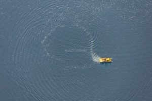 Aerial view of a yellow pedal boat on the large pond near Plößberg, Tirschenreuth - Klaus Leidorf Aerial Photography