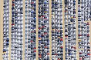 Aerial view of a newly constructed parking area for new vehicles in Ingolstadt-Zuchering - Klaus Leidorf Aerial Photography