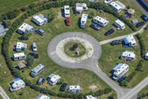 Aerial view of a red car on the campsite - Klaus Leidorf Aerial Photography