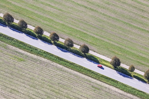 Aerial view of a red car on the B15 - Klaus Leidorf Aerial Photography