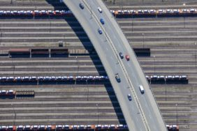 Aerial view of a red car on the bridge over the Munich-North marshalling yard - Klaus Leidorf Aerial Photography