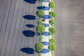Aerial view of a red car on an avenue - Klaus Leidorf Aerial Photography