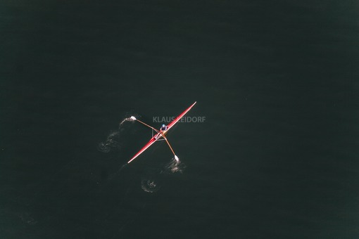 Aerial view of a red rowing sport boat - Klaus Leidorf Aerial Photography
