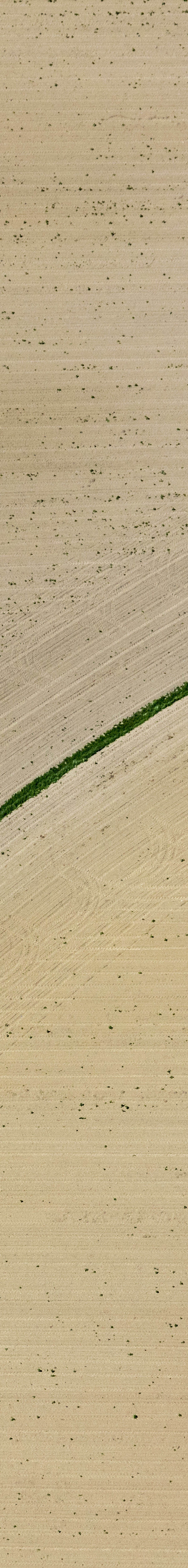 Aerial view of a narrow drainage ditch in the field - Klaus Leidorf Aerial Photography