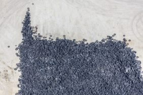 Aerial photograph of a waste tyre dump waiting to be burnt in the cement plant - Klaus Leidorf Aerial Photography