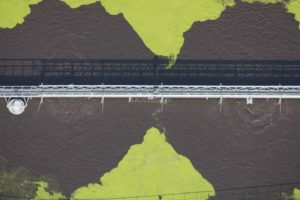 Aerial view of a bridge over a septic tank of a sewage treatment plant - Klaus Leidorf Aerial Photography