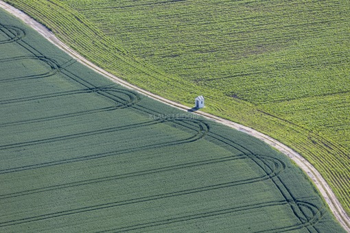 Aerial view of a field chapel on the field path between grain and corn fields - Klaus Leidorf Aerial Photography