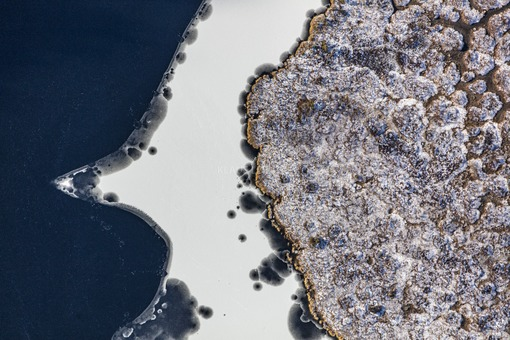 Aerial view of an island in the wintry Kleiner Arber See - Klaus Leidorf Aerial Photography