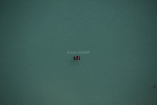 Aerial view of an air mattress on the bathing lake with two bathers - Klaus Leidorf Aerial Photography