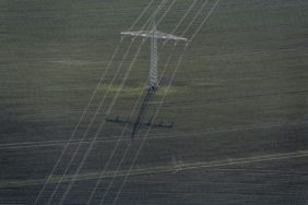 Aerial view of a power line over a field - Klaus Leidorf Aerial Photography