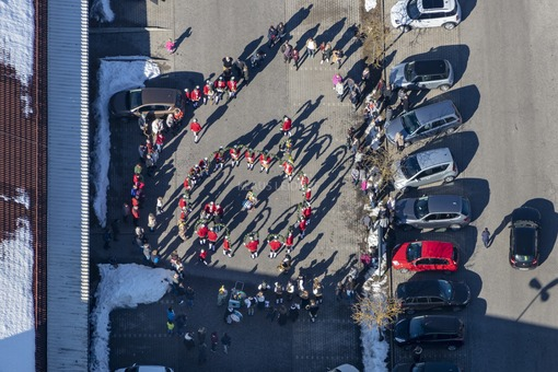 Aerial view of a dance group on the parking lot - Klaus Leidorf Aerial Photography