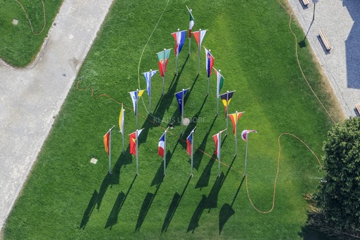 Aerial view of a triangular flag parade at the Kapellplatz in Altötting - Klaus Leidorf Aerial Photography