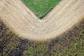 Aerial view of a green corner at the bent corn field edge - Klaus Leidorf Aerial Photography