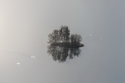 Aerial view of a small island in Lake Seeham - Klaus Leidorf Aerial Photography