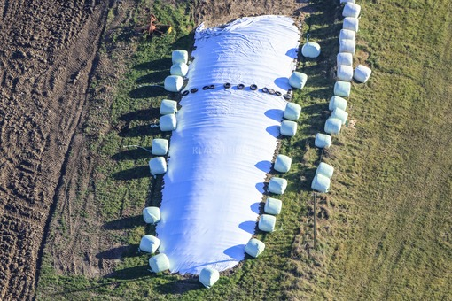 Aerial photograph of chopped maize at the edge of the field under a plastic sheet - Klaus Leidorf Aerial Photography