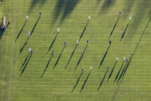 Aerial view of long shadows at a soccer match - Klaus Leidorf Aerial Photography