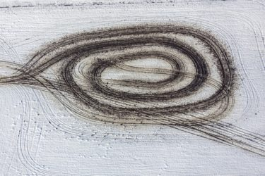 Aerial view of peasant painting on snow-covered field - Klaus Leidorf Aerial Photography