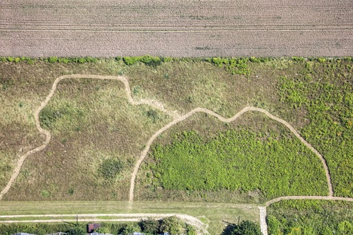 Aerial view of strange paths in the farmland - Klaus Leidorf Aerial Photography