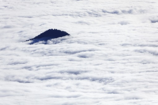 Aerial view of an island in a sea of fog - Klaus Leidorf Aerial Photography