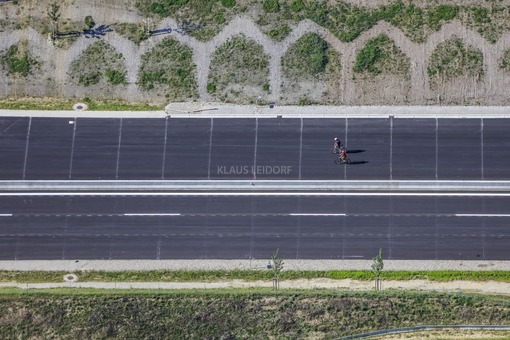 Aerial view of two cyclists on the A94 motorway near Lengdorf, which will open in a few weeks - Klaus Leidorf Aerial Photography