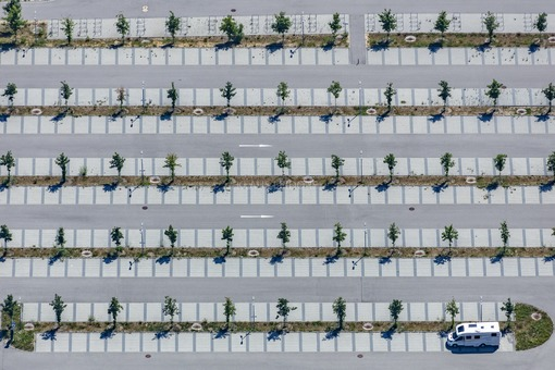 Aerial view of a Campervan on a parking lot at the soccer stadium in Regensburg-Oberisling - Klaus Leidorf Aerial Photography