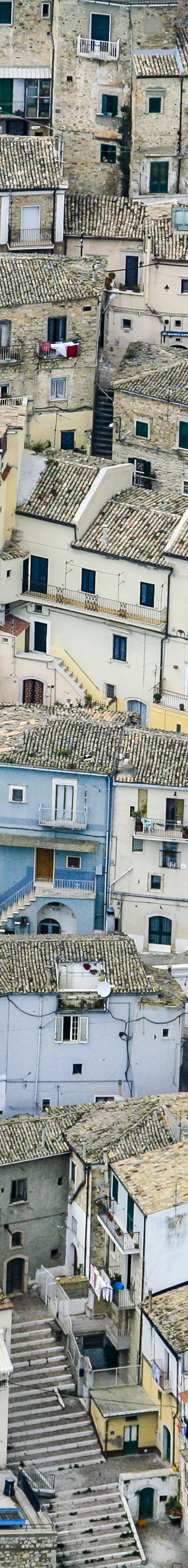Aerial view of the colourful houses of Sant Agata di Puglia in Apulia, Italy - Klaus Leidorf Aerial Photography