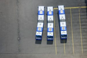 Aerial view of three buses at the bus base in Munich-Steinhausen - Aerial view of three buses at the bus base in Munich-Steinhausen - Klaus Leidorf Aerial Photography