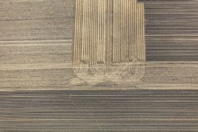Aerial view of a potato field with grafic tracks - Klaus Leidorf Aerial Photography