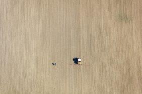 Aerial view of a farmer with a tractor on the field - Klaus Leidorf Aerial Photography